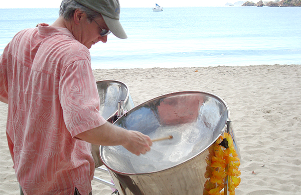 Man Playing Steel Drums On Beach